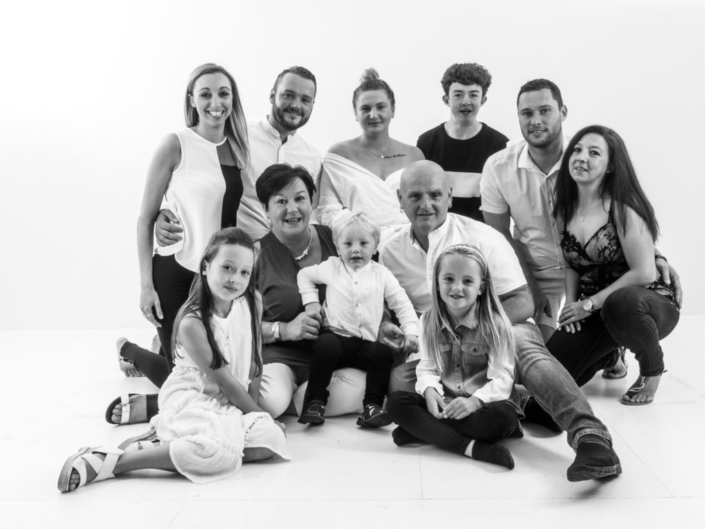 Black and white family portrait by studio G Photography Oldham